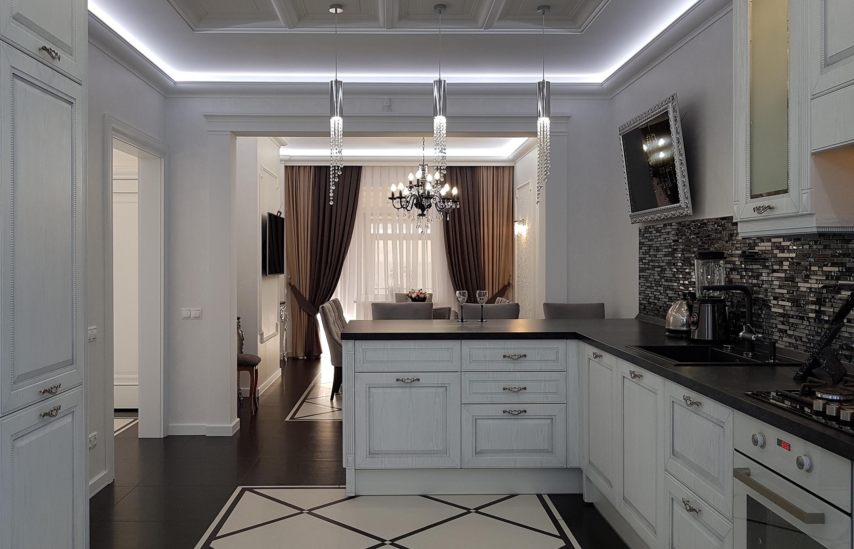 Интерьер кухни совмещенной со столовой