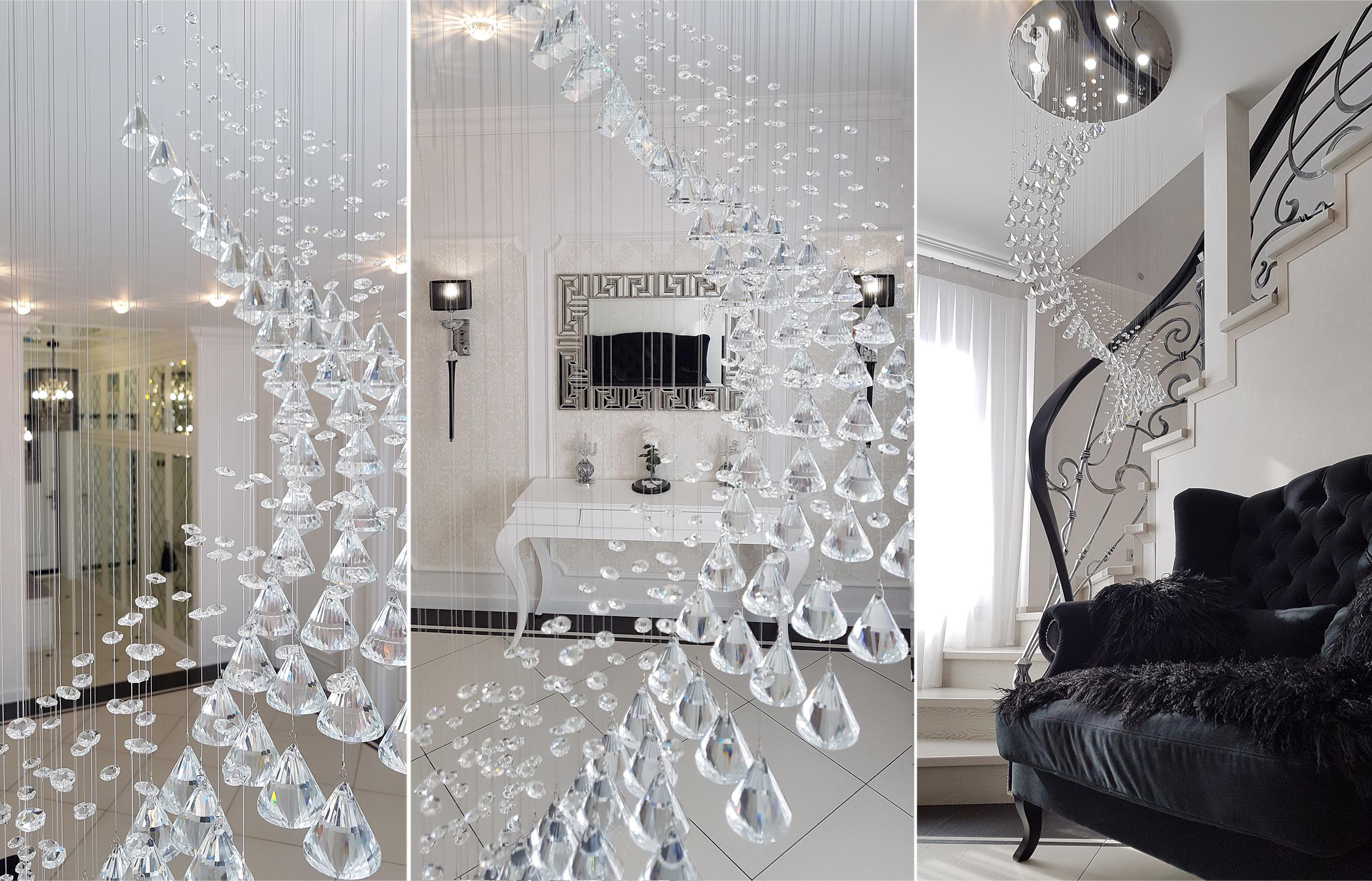 Дизайн интерьера холла с кованой лестницей